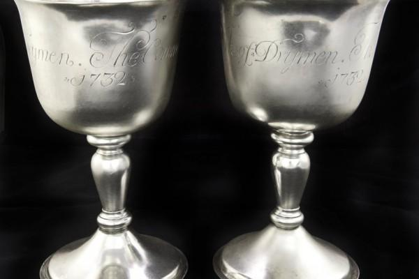 image shows two silver communion goblets made by Johan Gottleif Bilsinds inscribed 'The Communion Cups of the Kirk of Drymen 1732'